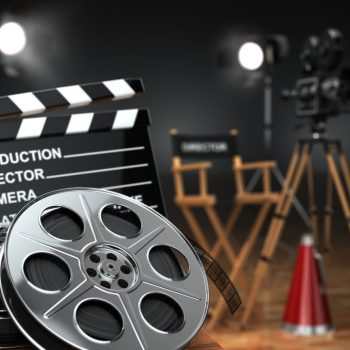 Video, movie, cinema concept. Retro camera, reels, clapperboard